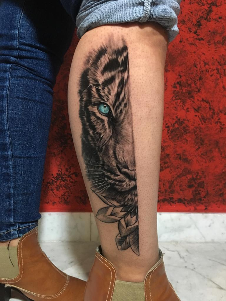 Lion Half Leg tattoo with blue eyes